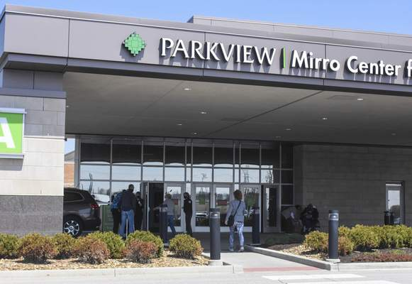 Michelle Davies | The Journal Gazette People entering the Mirro Center Friday afternoon for COVID-19 vaccines.