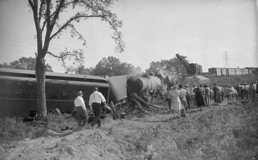 File photos People gather around the crash site where the Grand Rapids & Indiana RailroadNo. 508 passenger train collided with an earth mover at a crossing on California Road, killing three and injuring more than a dozen, Oct. 7, 1947.