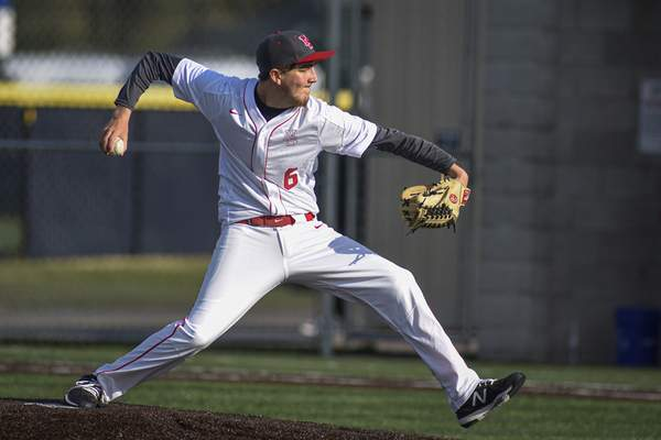 Mike Moore | The Journal Gazette North Side's pitcher Anthony Deck pitching in the third inning against Bishop Dwenger at the World Baseball Academy on Thursday.