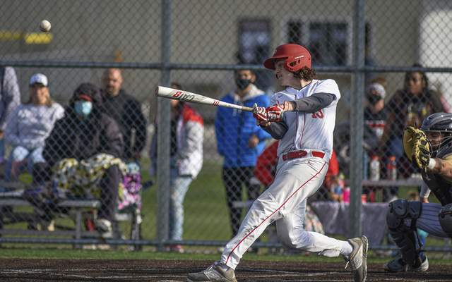 Mike Moore | The Journal Gazette North Side's Chris Bauer at bat in the third inning against Bishop Dwenger at the World Baseball Academy on Thursday.