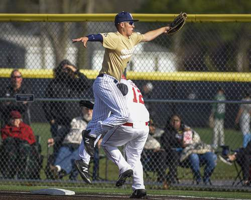 Mike Moore | The Journal Gazette Bishop Dwenger first baseman Kasen Oribello leaps to catch a wild throw in the second inning against North Side at the World Baseball Academy on Thursday.