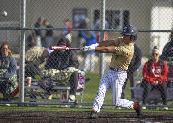 Mike Moore | The Journal Gazette Bishop Dwenger's Xavier Aguirre hits an RBI double in the third inning against North Side at the World Baseball Academy on Thursday.