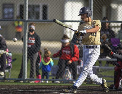 Mike Moore | The Journal Gazette Bishop Dwenger's Bohde Dickerson at bat in the third inning against North Side at the World Baseball Academy on Thursday.