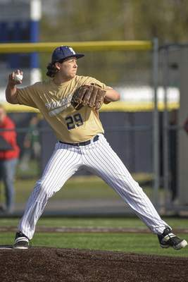 Mike Moore | The Journal Gazette Bishop Dwenger pitcher Ashton Hall pitching in the second inning against North Side at the World Baseball Academy on Thursday.