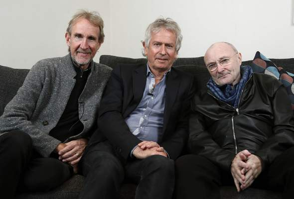 FILE - In this March 4, 2020 file photo, Genesis band members from left, Mike Rutherford, Tony Banks, and Phil Collins pose for a photo during an interview in London. (AP Photo/Frank Augstein, File)