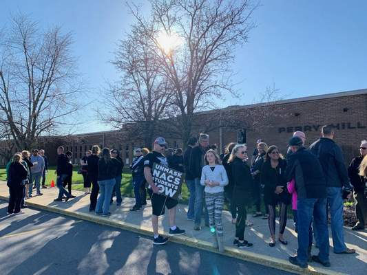 FILEParents and students protest outside the Northwest Allen County Schools board in March.