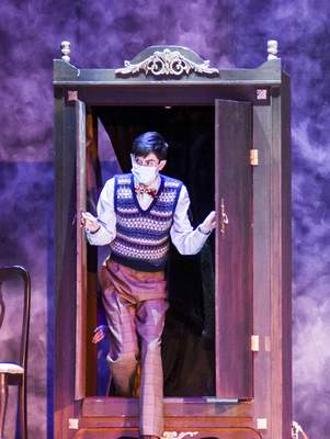 "The character Edmund, played by Landon Richey, peeks out of the closet during the rehearsal for the Fort Wayne Youtheatre production ""The Lion, the Witch and the Wardrobe."""