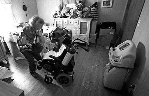 Associated Press Private-duty registered nurse Deb Bronner tends to her patient Zachary at the home of his foster-to-adopt parents in Springfield, Massachusetts.