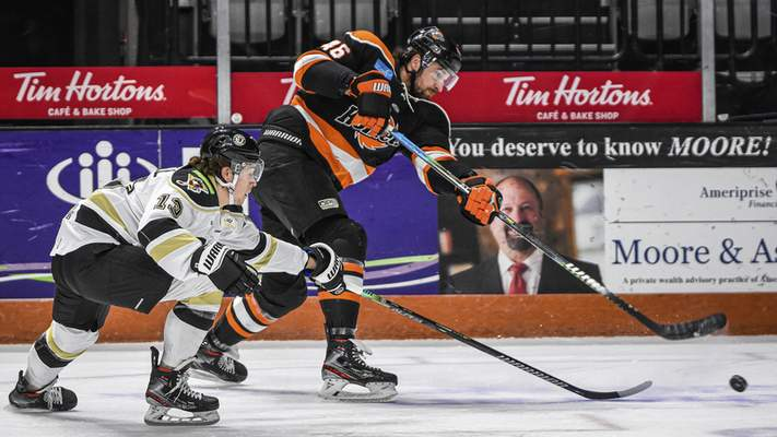 Mike Moore | The Journal Gazette Komets forward Justin Vaive takes a shot at the net in the first period against Wheeling at Memorial Coliseum on Friday.