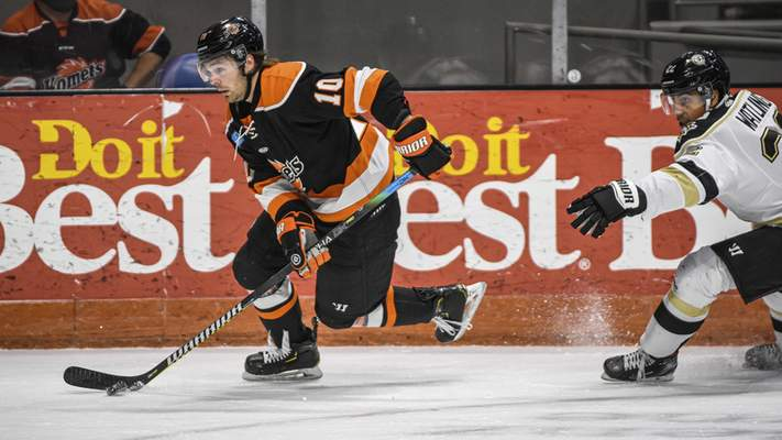 Mike Moore | The Journal Gazette Komets defenseman Nick Boka controls the puck in the first period against Wheeling at Memorial Coliseum on Friday.