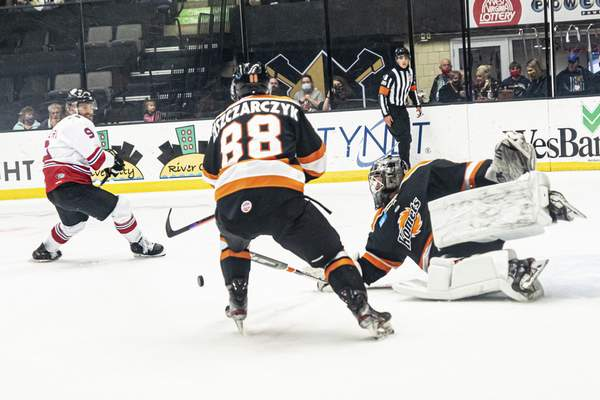 Zack Rawson | Special to The Journal Gazette  Komets forward Alan Lyszczarczyk and goalie Trevor Gorsuch, right, defend the net from the Wheeling Nailers' Nick Rivera on Saturday in Wheeling, West Virginia.