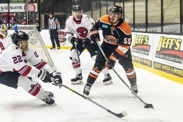 Zack Rawson | Special to The Journal Gazette Komets forward Jackson Leef, right, looks to make a pass as he's defended by the Wheeling Nailers' Patrick Watling on Saturday in Wheeling, W.Va.