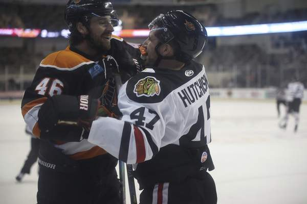 Whiteshark Photography  The Komets' Justin Vaive, left, begins a tussle with the Indy Fuel's Nick Hutchison that soon turns into a full-fledged fight Sunday in Indianapolis.