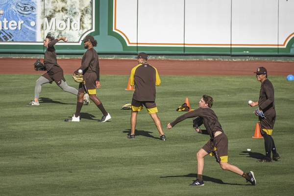 Mike Moore | The Journal Gazette Members of the TinCaps  warm up at Parkview Field on Friday. The season opens Tuesday against West Michigan.