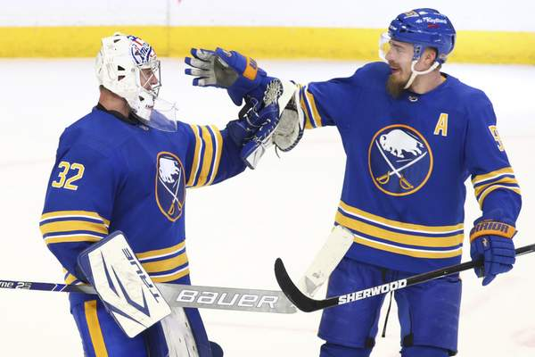 Associated Press  Buffalo Sabres goalie Michael Houser (32) celebrates a victory over the New York Islanders with Defenseman Rasmus Ristolainen (55) following the third period of an NHL hockey game against the New York Islanders, Monday, May 3, 2021, in Buffalo, N.Y. (AP Photo/Jeffrey T. Barnes)