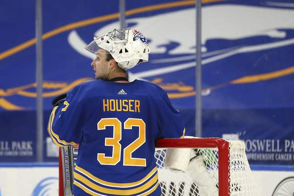 Buffalo Sabres goalie Michael Houser (32) looks on during the second period of an NHL hockey game against the New York Islanders, Monday, May 3, 2021, in Buffalo, N.Y. (AP Photo/Jeffrey T. Barnes)