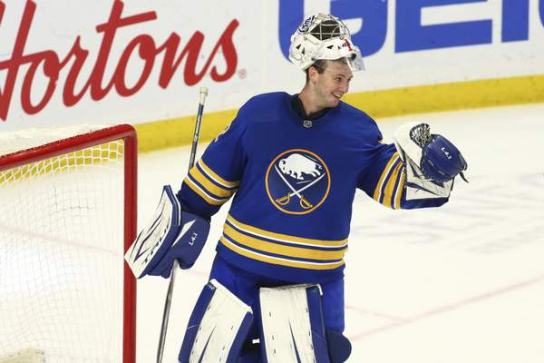 Buffalo Sabres goalie Michael Houser (32) celebrates a victory over the New York Islanders following the third period of an NHL hockey game against the New York Islanders, Monday, May 3, 2021, in Buffalo, N.Y. (AP Photo/Jeffrey T. Barnes)
