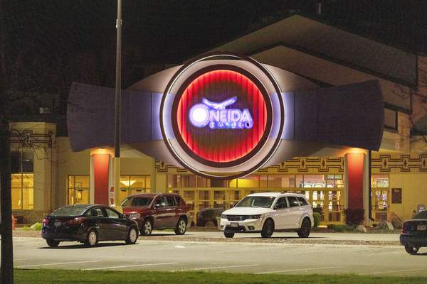 The Oneida Casino lights glow in the parking lot in the early morning hours of Sunday, May 2nd, 2021, near Green Bay, Wisconsin. (AP Photo/Mike Roemer)