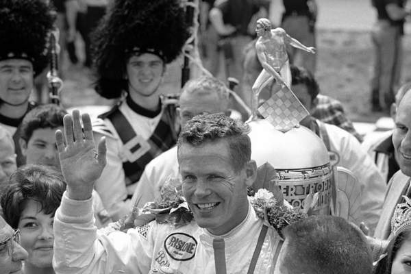 FILE - In this May 30, 1968, file photo, Bobby Unser celebrates winning the 52nd running of the Indianapolis 500 auto race at Indianapolis Motor Speedway in Indianapolis, Ind. Three-time Indianapolis 500 winner Bobby Unser has died. He died of natural causes at his home in Albuquerque, New Mexico, on Sunday, May 2, 2021. He was 87.(AP Photo/File)