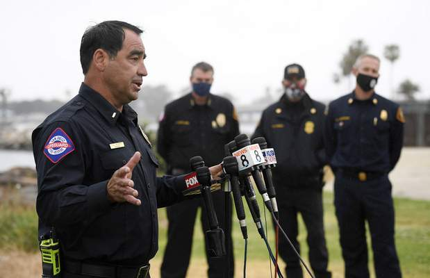 San Diego Lifeguard Lt. Rick Romero speaks at a news conference held after a boat capsized just off the San Diego coast Sunday, May 2, 2021, in San Diego. (AP Photo/Denis Poroy)