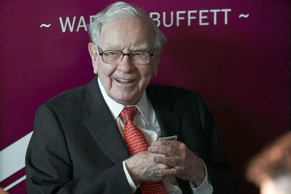 FILE - In this May 5, 2019, file photo Warren Buffett, Chairman and CEO of Berkshire Hathaway, smiles as he plays bridge following the annual Berkshire Hathaway shareholders meeting in Omaha, Neb. (AP Photo/Nati Harnik, File)