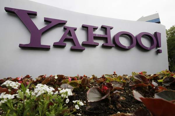 FILE - The Yahoo logo is displayed outside of offices in Santa Clara, Calif., in this Monday, April 18, 2011, file photo. (AP Photo/Paul Sakuma, File)