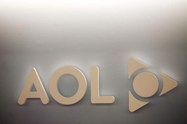 FILE - The AOL logo is shown on a wall of the company's New York office, in this Monday, May 12, 2008, file photo. (AP Photo/Mark Lennihan, File)