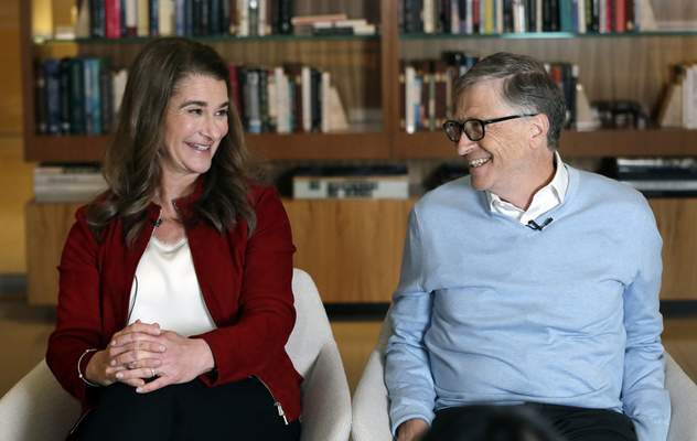 Associated Press Bill and Melinda Gates smile at each other during a February 2019 interview in Kirkland, Wash.