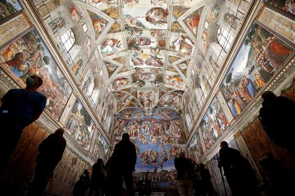 Associated Press Visitors admire the Sistine Chapel inside the Vatican Museums in Rome on Monday as the museums reopened after a pandemic-related shutdown.