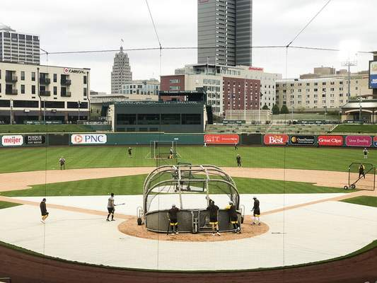 Katie Fyfe | The Journal Gazette The TinCaps practice Monday evening at Parkview Field in preparation for today's season opener.