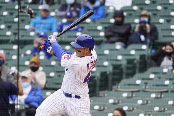 Chicago Cubs' Anthony Rizzo (44) hits a one run single against the Los Angeles Dodgers during the first inning of the first baseball game of a doubleheader Tuesday, May, 4, 2021, in Chicago. (AP Photo/David Banks)