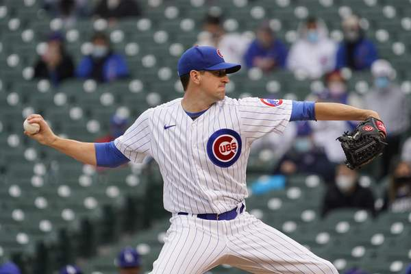 Chicago Cubs starting pitcher Kyle Hendricks throws the ball against the Los Angeles Dodgers during the first inning of the first baseball game of a doubleheader Tuesday, May, 4, 2021, in Chicago. (AP Photo/David Banks)