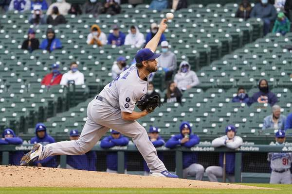 Los Angeles Dodgers starting pitcher Clayton Kershaw throws the ball against the Chicago Cubs during the first inning of the first baseball game of a doubleheader Tuesday, May, 4, 2021, in Chicago. (AP Photo/David Banks)