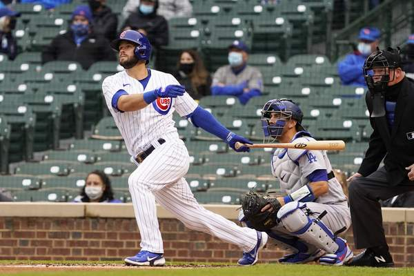 Chicago Cubs' David Bote hits a three run double against the Los Angeles Dodgers during the first inning of the first baseball game of a doubleheader Tuesday, May, 4, 2021, in Chicago. (AP Photo/David Banks)