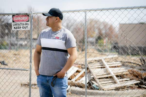 Fidel Martinez stands for a portrait at one of his former worksites in Minneapolis on Sunday, April 18, 2021. (AP Photo/John Minchillo)