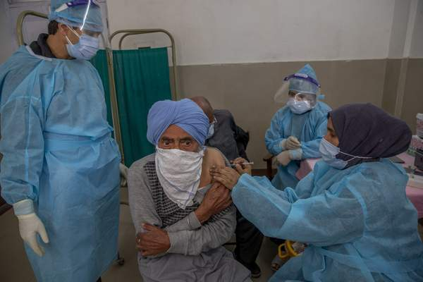 FILE - In this April 28, 2021, file photo, a Kashmiri man receives a vaccine for COVID-19 at a primary health center in Srinagar, Indian controlled Kashmir. (AP Photo/Dar Yasin, File)