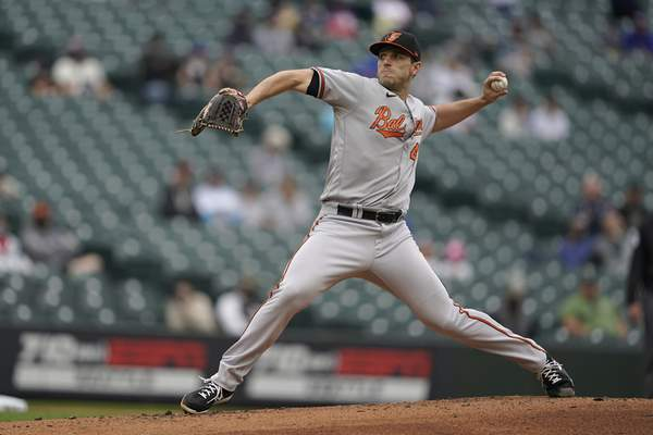 Baltimore Orioles starting pitcher John Means throws against the Seattle Mariners during the third inning of a baseball game, Wednesday, May 5, 2021, in Seattle. (AP Photo/Ted S. Warren)