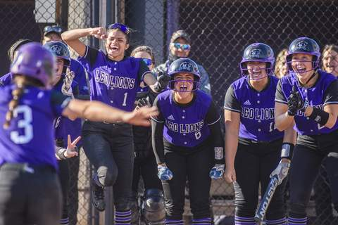 Mike Moore   The Journal Gazette The Leo Lions softball team welcomes infielder Ali Davis home Wednesday after she hit a home run in the second inning against Bellmont at Leo on Wednesday.