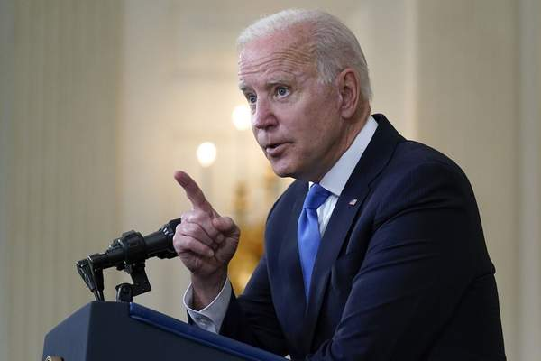 Associated Press President Joe Biden takes questions from reporters Wednesday at the White House.