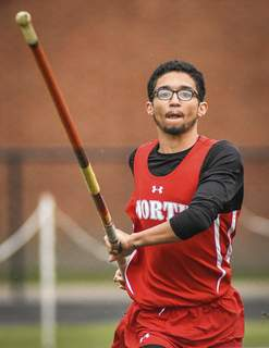 Mike Moore | The Journal Gazette North Side senior Isaiah Adams competes in the pole vault during the SAC Track and Field Championships at North Side High School on Thursday.