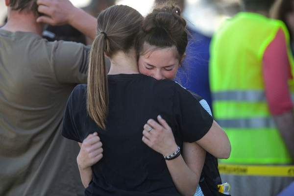 Students embrace after a school shooting at Rigby Middle School in Rigby, Idaho on Thursday, May 6, 2021. (John Roark /The Idaho Post-Register via AP)