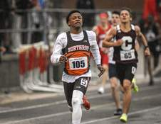 Mike Moore | The Journal Gazette Northrop senior Darrius Sanders runs the 400 meter dash during the SAC championships at North Side High School on Thursday.