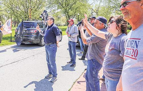 The Times of Northwest Indiana Mayor Thomas McDermott Jr., giving a thumb's up, and other Hammond residents welcome protesters to the city Saturday.