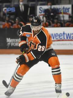 Katie Fyfe | The Journal Gazette  Komets forward Matthew Boudens carries the puck during the first period against the Indy Fuel at Memorial Coliseum.