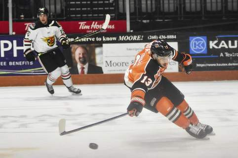 Katie Fyfe | The Journal Gazette  Komets forward Anthony Petruzzelli chases the puck during the first period against the Indy Fuel at Memorial Coliseum on Friday.