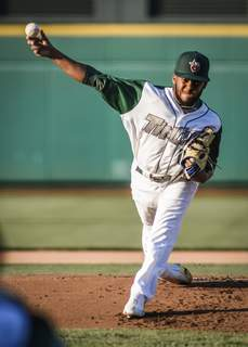 Mike Moore | The Journal Gazette TinCaps pitcher Edgar Martinez pitches in the first inning against West Michigan at Parkview Field on Friday.