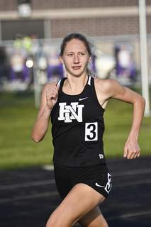 Katie Fyfe | The Journal Gazette  Huntington North's Addy Wiley leads the pack during the 1600 meter dash during the NE8 Track and Field Championships at New Haven Jr/Sr High School on Friday.