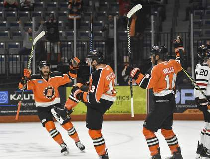 Katie Fyfe | The Journal Gazette  The Komets celebrate after Anthony Petruzzelli scores the first point of the game during the first period against the Indy Fuel at Memorial Coliseum on Friday.