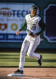 Mike Moore | The Journal Gazette TinCaps third baseman Justin Lopez steps on the bag for an out to end the top of the first against West Michigan at Parkview Field on Friday.