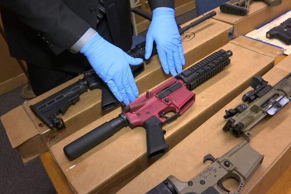 FILE - In this file photo taken Wednesday, Nov. 27, 2019, is Sgt. Matthew Elseth with ghost guns on display at the headquarters of the San Francisco Police Department in San Francisco. A federal appeals court in San Francisco has ruled that plans for 3D-printed, self-assembled ghost guns can be posted online without U.S. State Department approval. The San Francisco Chronicle says the 2-1 decision was made Tuesday, April 27, 2021, by the 9th U.S. District Court of Appeals. (AP Photo/Haven Daley,File)